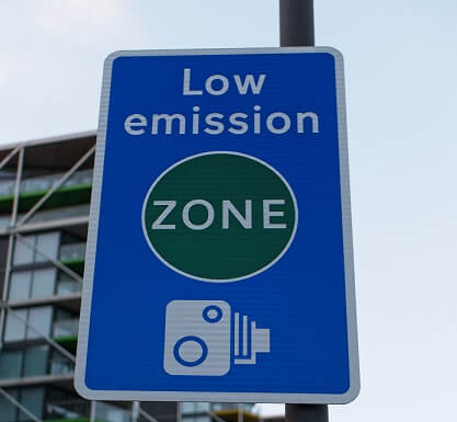 Close-up Detail of Low Emission Zone Traffic Sign with Camera Tutor for Violations and Fines.
